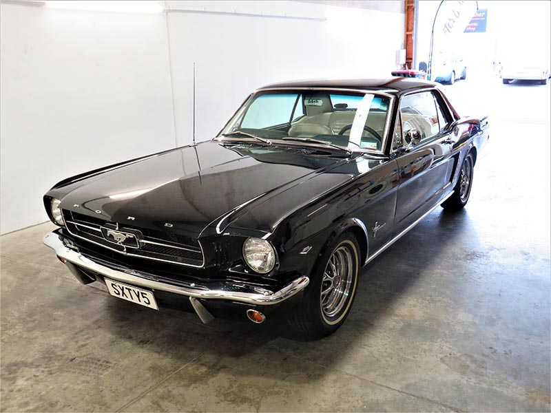 Vintage black mustang with Doctor Cuts detail finish