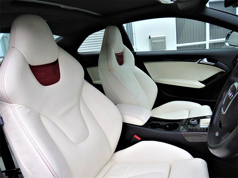 Interior vehicle detailing of white leather interior